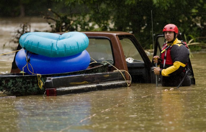 Austin Tuttiardo,  a Strasburg volunteer firefighter and member of the swift water rescue team, checks this truck at Chapman's Landing south of Woodstock on Monday morning. Nobody was in the truck. Rich Cooley/Daily
